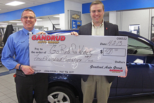 Gandrud Donation Check to Go Red for Women