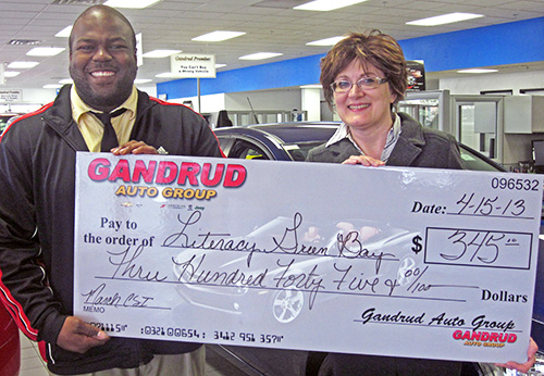 Gandrud Donation Check to Literacy Green Bay